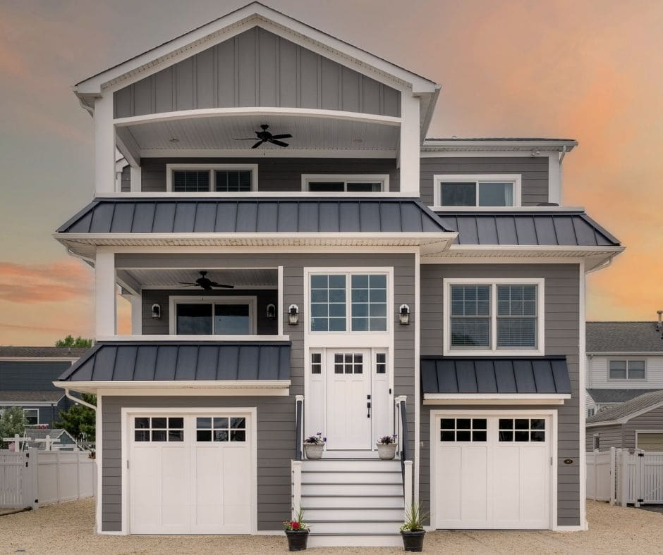 grey beach house in beach haven with 2 garages by GTG builders