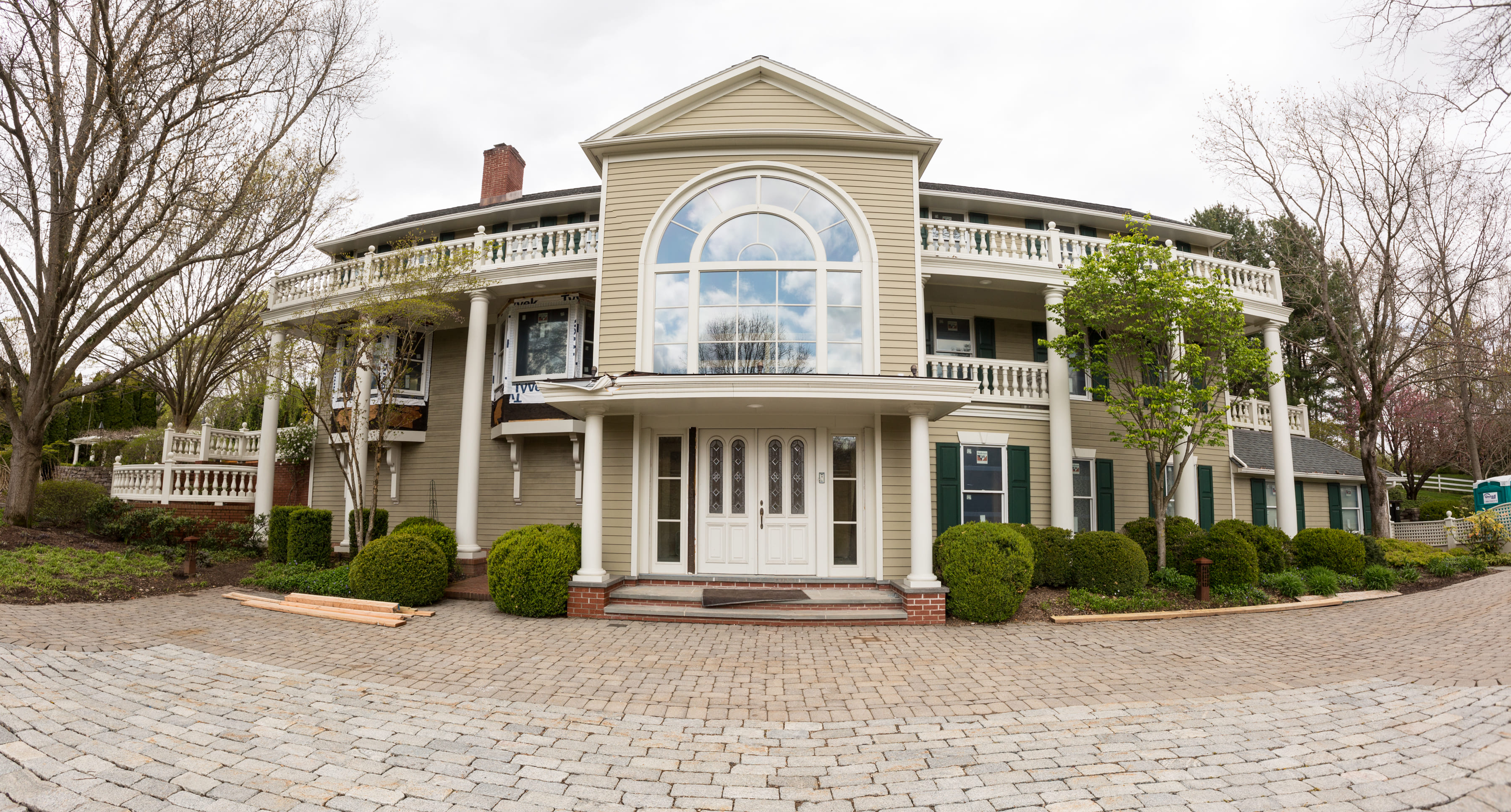 custom home with large window in potterstown nj by GTG custom home builders